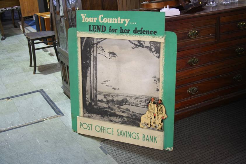 Lot 76 - A large Post Office savings bank World War II poster 'Your Country …. lend for her Defence'