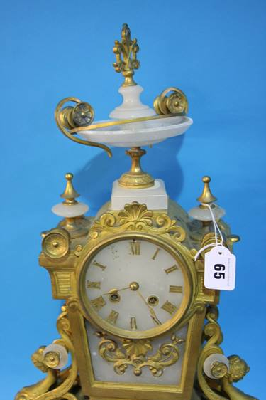 Lot 65 - A gilt metal and marble mantle clock