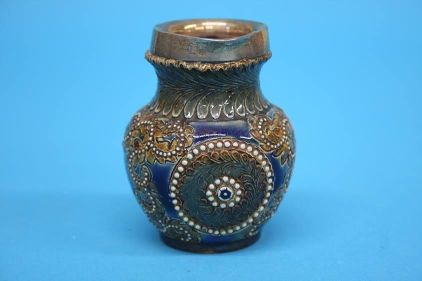 Lot 16 - A Doulton Lambeth stoneware 'Gladstone jug', a small siver rimmed jug, a Royal Doulton Series Ware