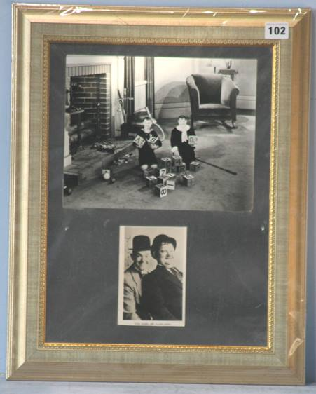 Lot 102 - Laurel and Hardy, both signatures on a photograph of them (Hardy's faded) framed with larger black