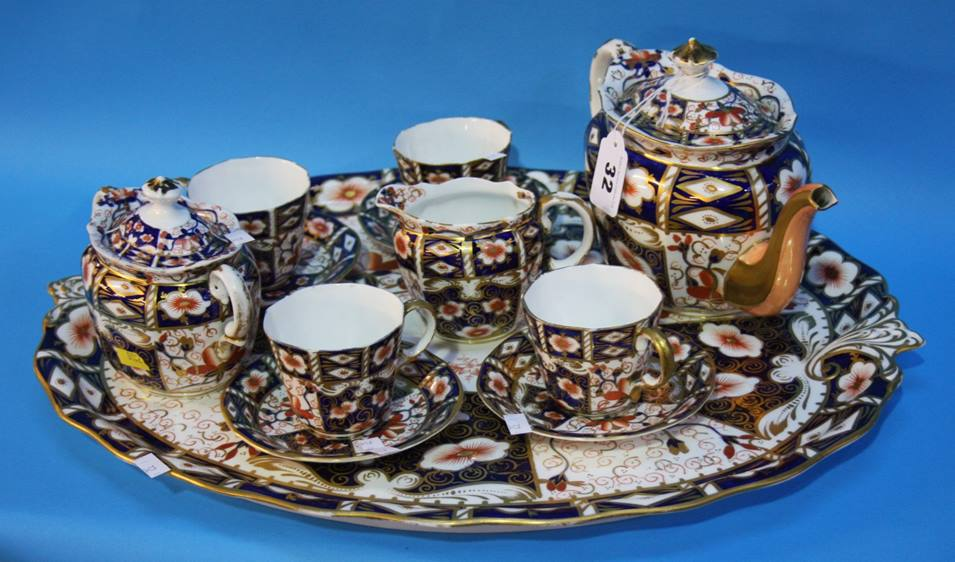 Lot 32 - A Royal Crown Derby Imari pattern cabaret set comprising; tray, four tea cups and saucers, cream jug