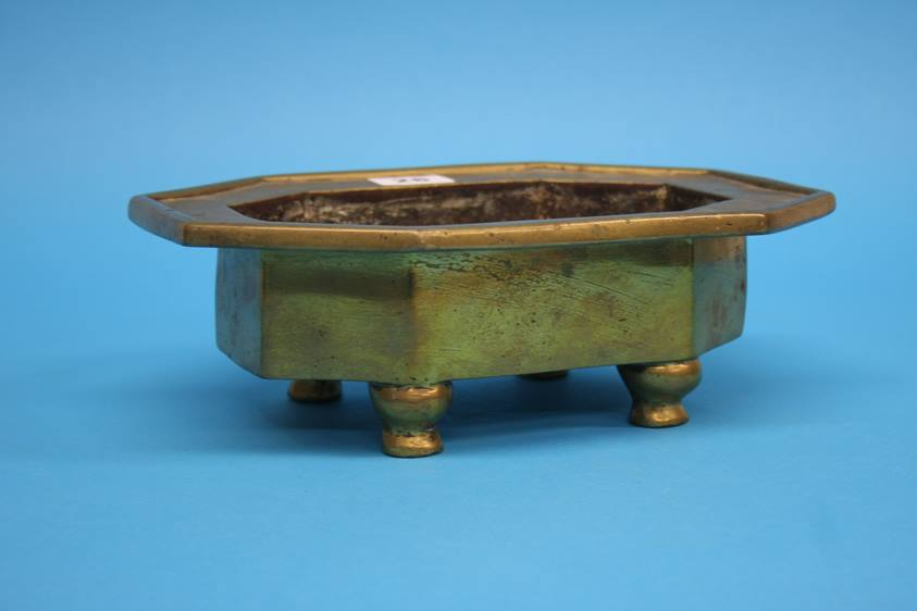 Lot 26 - An early octagonal gilt bronze Chinese heavy censer on four strut feet, 19th century or earlier.