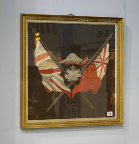 Lot 53 - A framed embroidery of the Canadian and British flags
