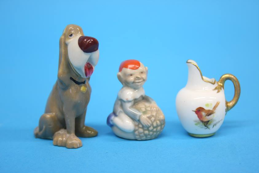 Lot 29 - A Beswick 'Swiss' roll kitten, a Royal Worcester miniature jug decorated with a robin, two miniature