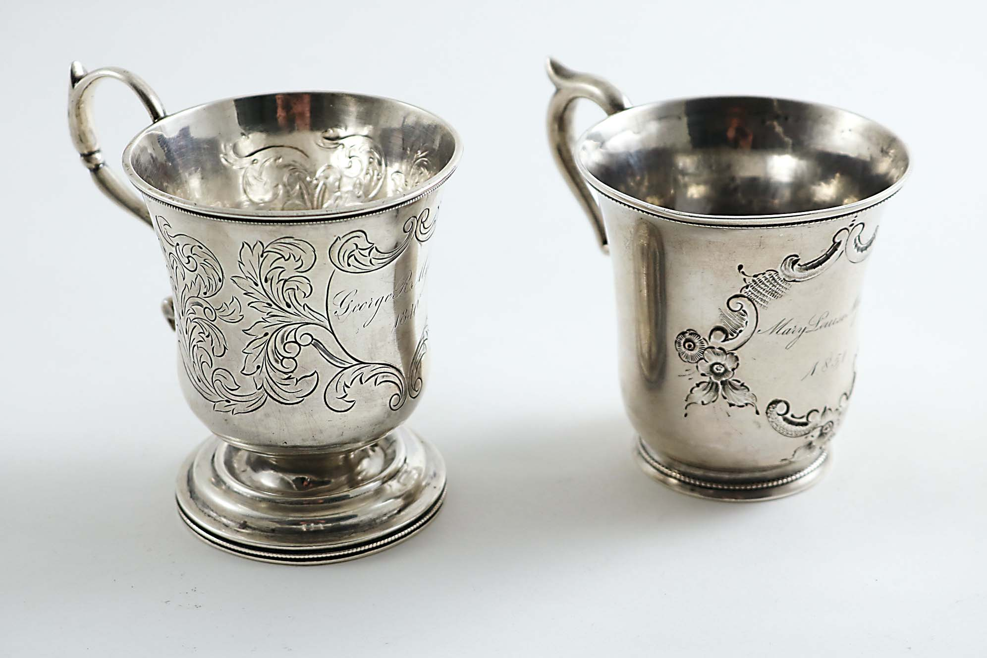 Lot 475 - TWO MID-19TH CENTURY AMERICAN CHRISTENING MUGS with campana-shaped bowls: one with a circular