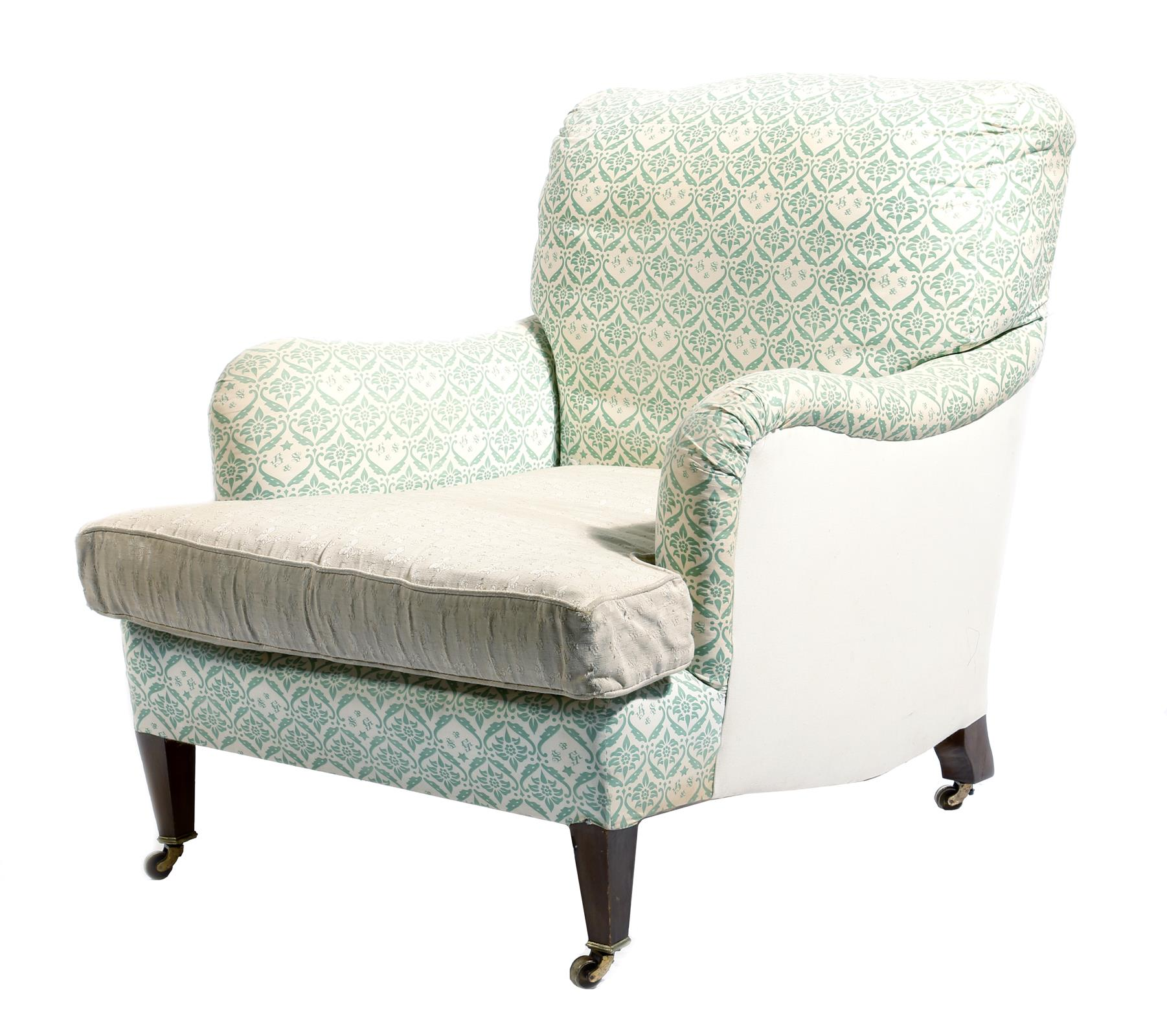 Lot 709 - An easy armchair by Howard Chairs, with part 'H & S' monogrammed ticking, on beechwood legs, the