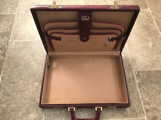 Lot 545 - A fine burgundy leather brief case with