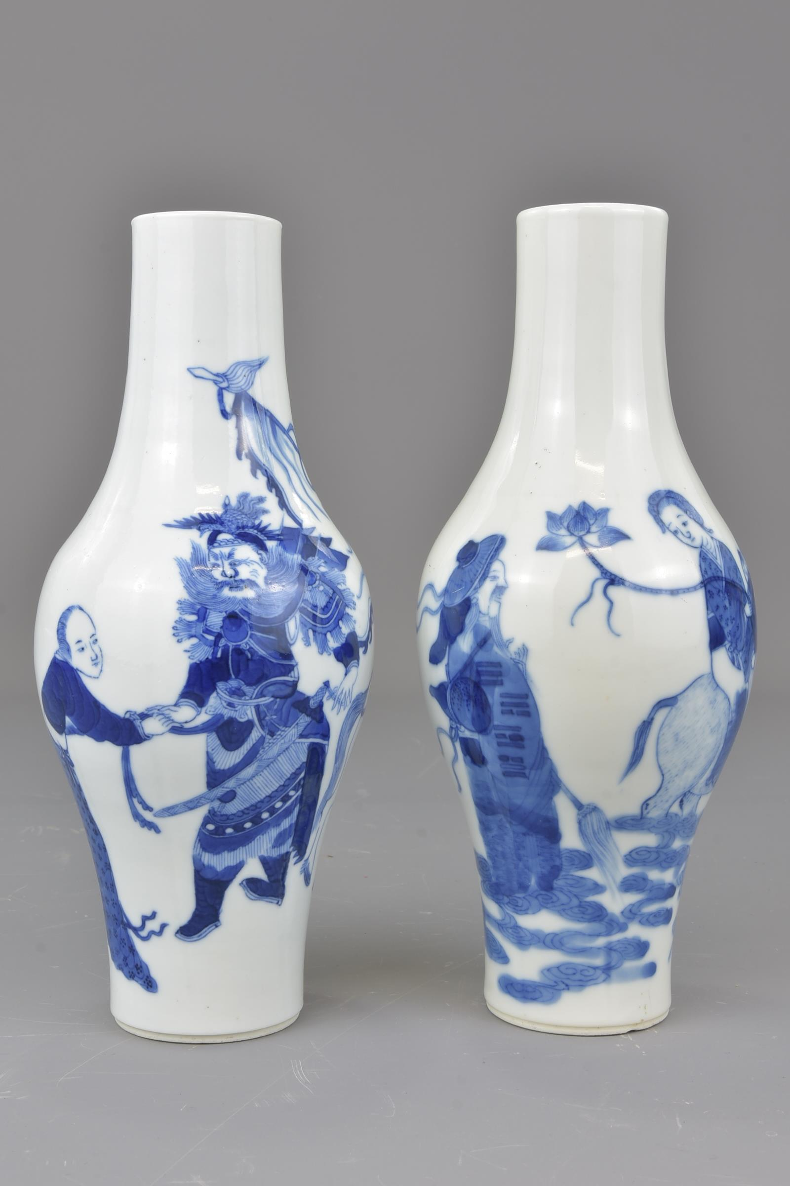 Lot 52 - A fine pair of Chinese 19th century blue and white olive shaped porcelain vases decorated with figur