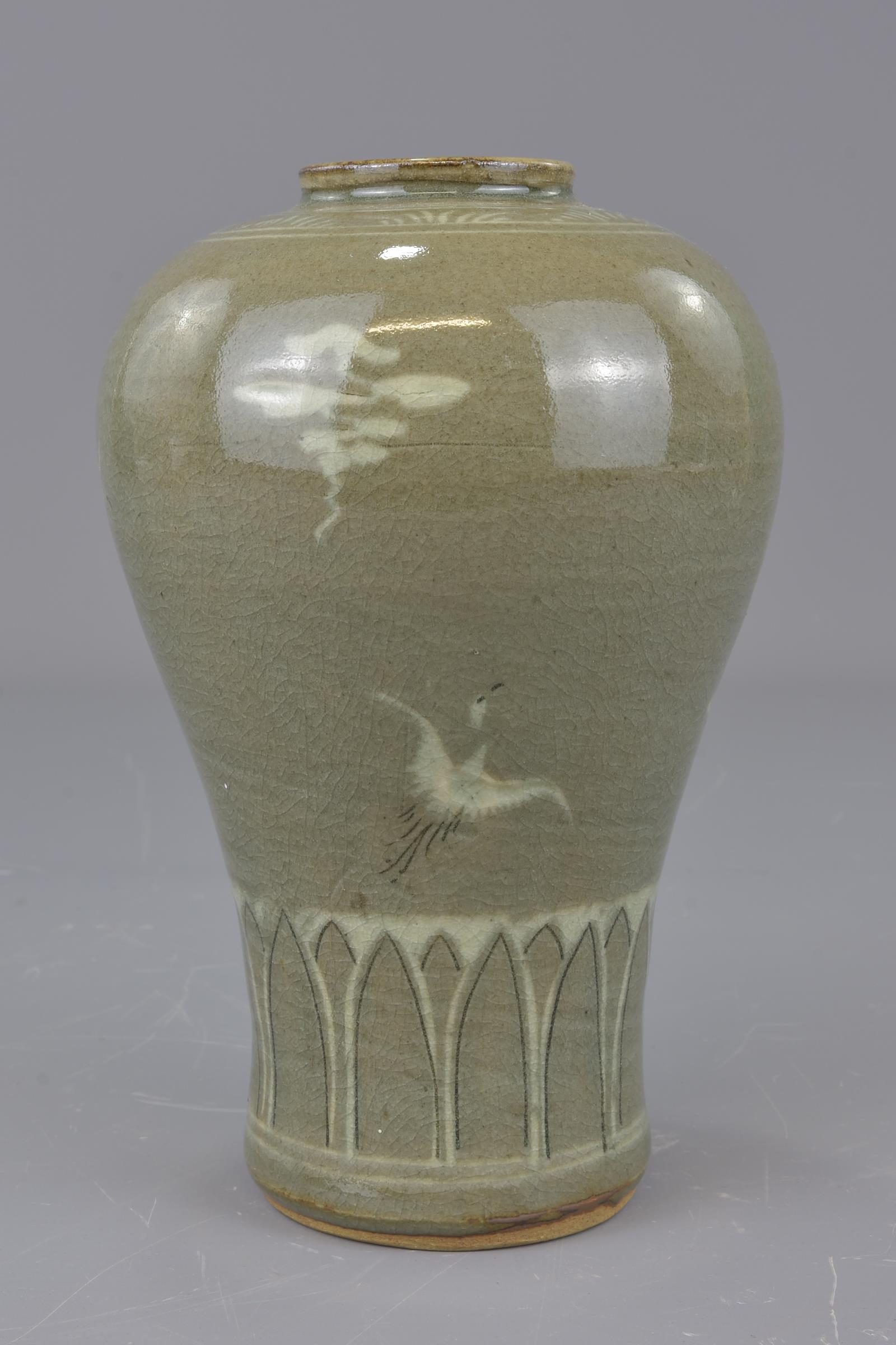 Lot 42 - Two Korean 20th century celadon porcelain items. One vase and one bowl. 15cm diameter and 19cm tall