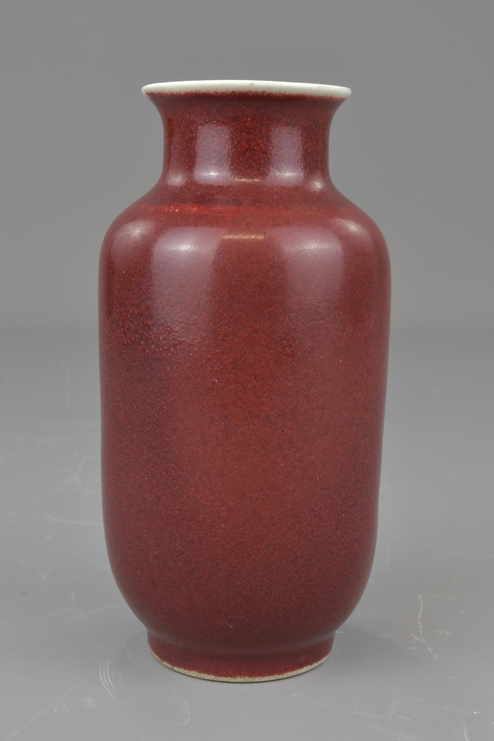 Lot 40 - A Chinese 19th century red glazed porcelain vase. 16cm height