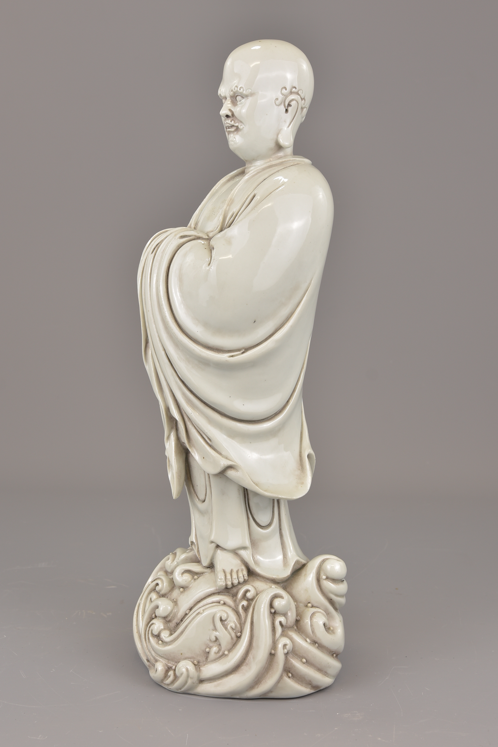Lot 13 - A Chinese 19th century Blanc de Chine porcelain figure of Luohan with four character temple name to