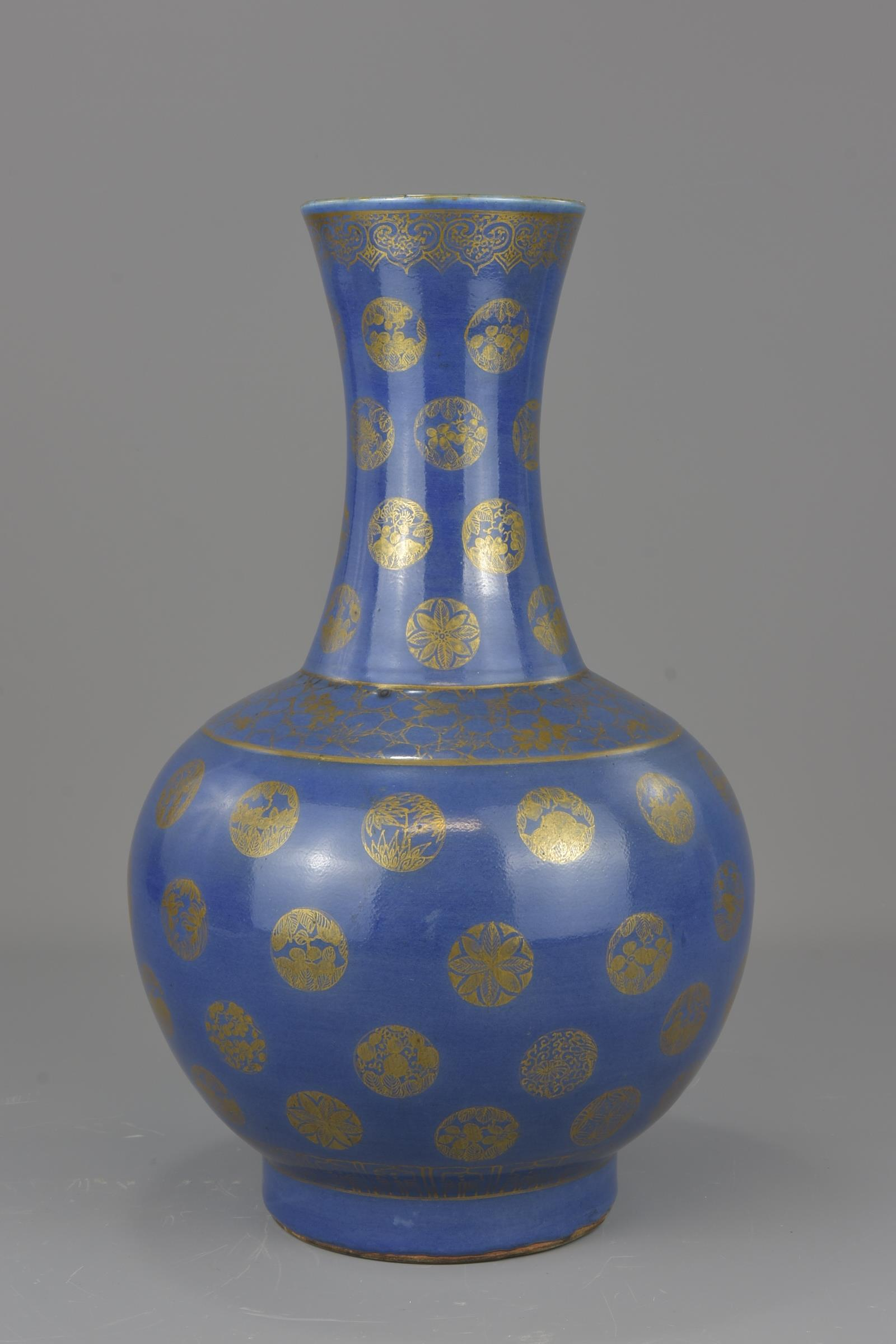 Lot 27 - A Chinese 19th century blue glazed porcelain bottle vase mark and period of GuangXu. 38cm tall