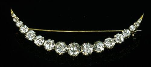 Lot 40 - A late Victorian diamond set crescent brooch