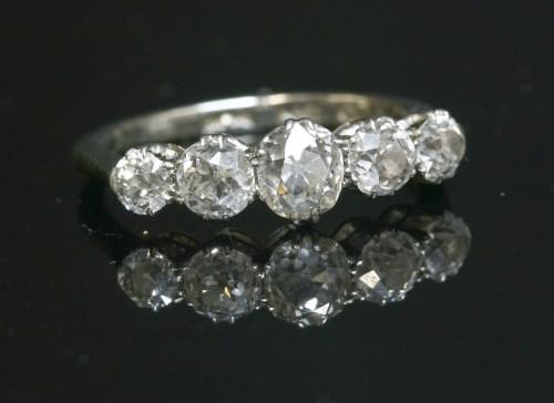 Lot 42 - A graduated five stone diamond ring with old European cut diamonds