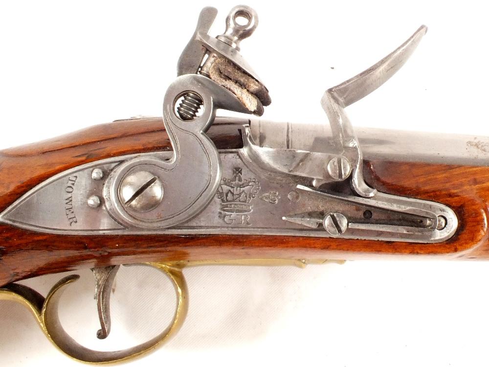 Lot 73 - A long Flintlock Sea Service pistol in .