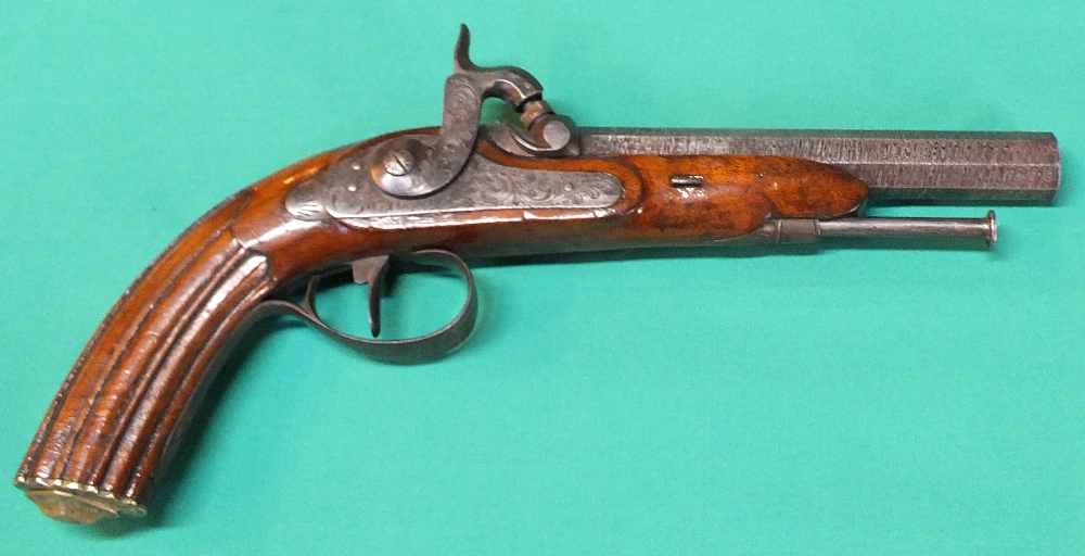 Lot 64 - A percussion target pistol with fluted grip to stock and Damascus barrel,