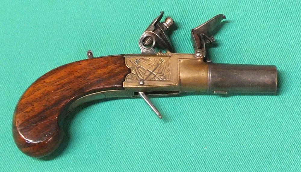 Lot 65 - A brass framed Flintlock pocket pistol with concealed trigger,