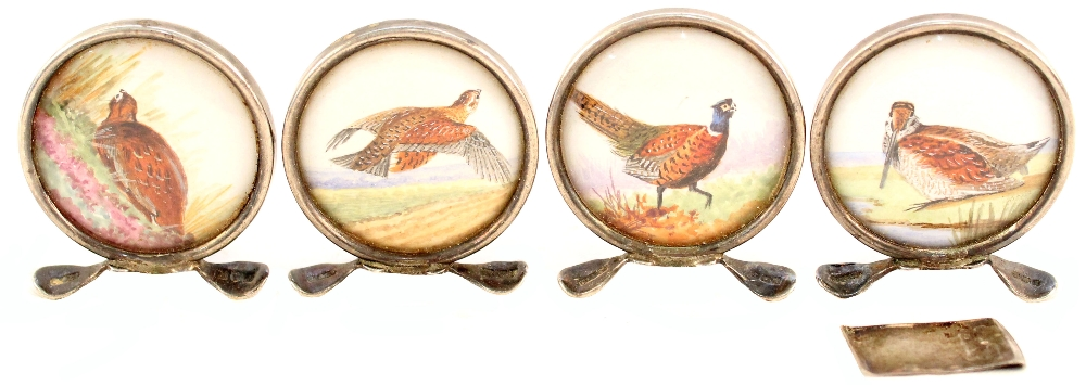 A set of four silver menu holders depicting game birds (one stand as found)