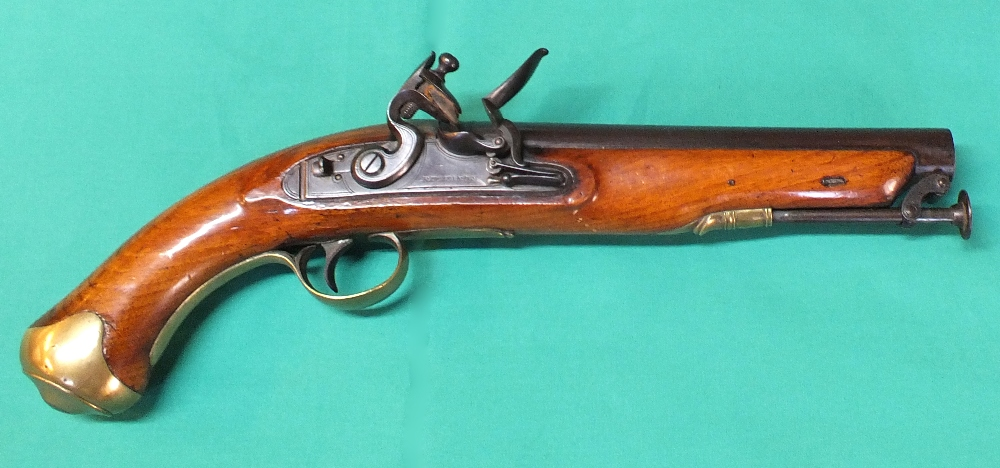 Lot 72 - A Flintlock pistol with brass furniture and captive ramrod, lock with border line engraving,