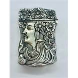 A silver plated vesta case with art nouveau style figure to the decorated case