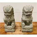 A pair of Foo Dog garden statutes