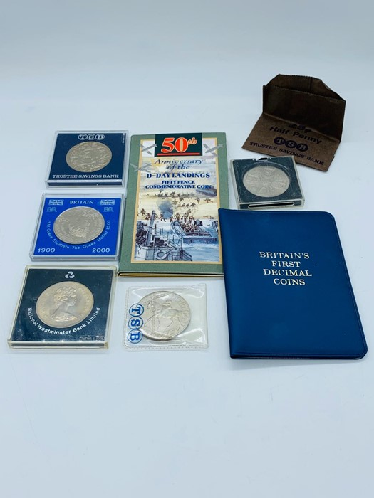 A small selection of coins to include Crowns and presentation packs.