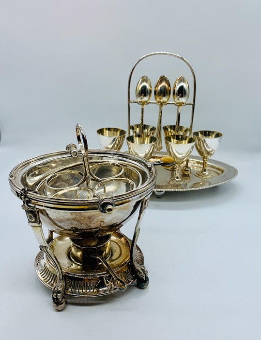 Lot 37 - A silver plated egg serving set