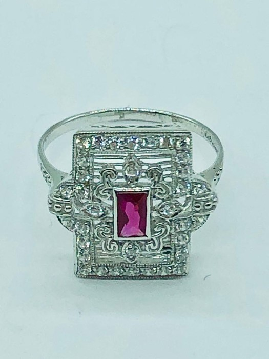 Lot 89 - A silver and cz art deco style ring with central ruby panel