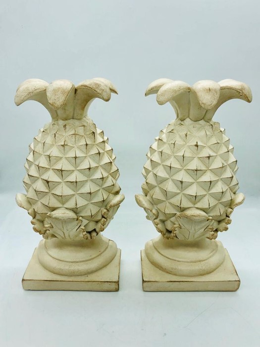 A pair of resin pineapple bookends