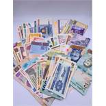 One Hundred Worldwide Bank Notes mixed condition.