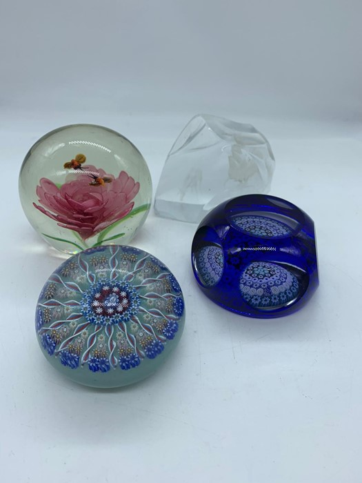 Lot 142 - Four glass paperweights, two millefiori