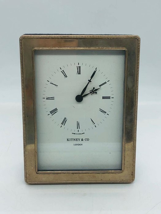 Lot 10 - A hallmarked silver Witney & Co clock.