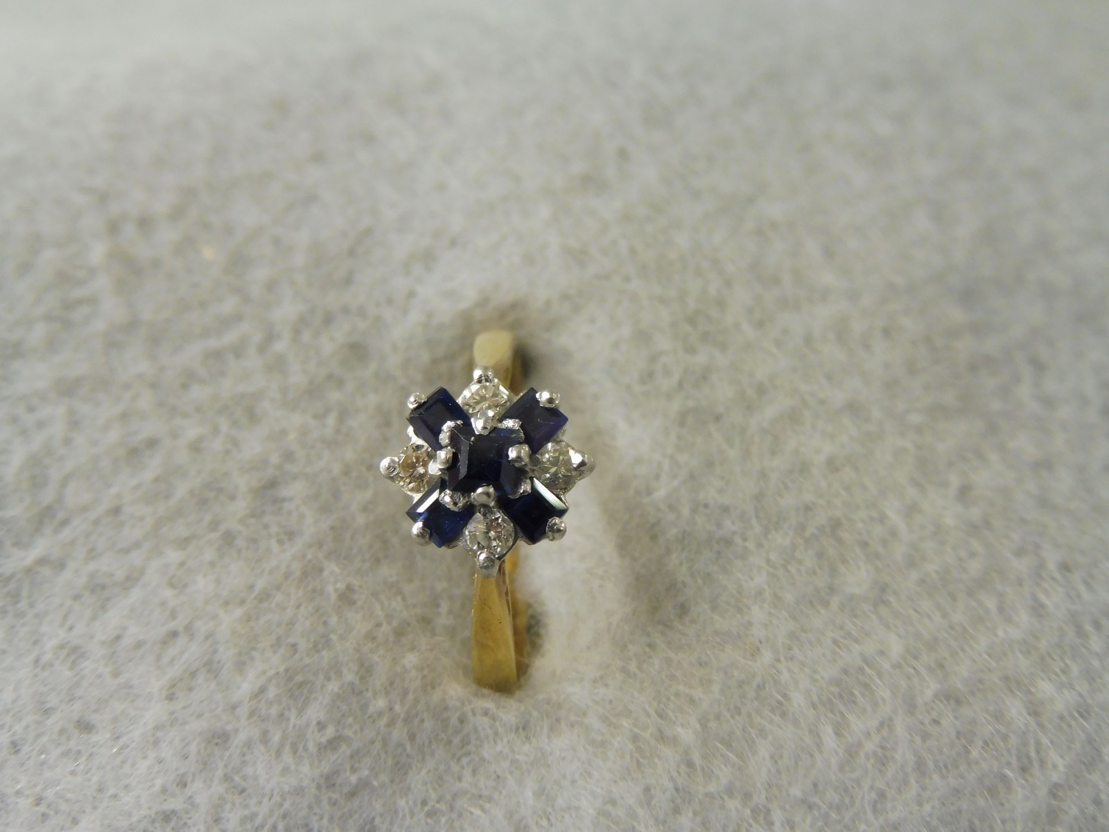 Lot 10 - A diamond and sapphire ring in platinum and 18ct gold.