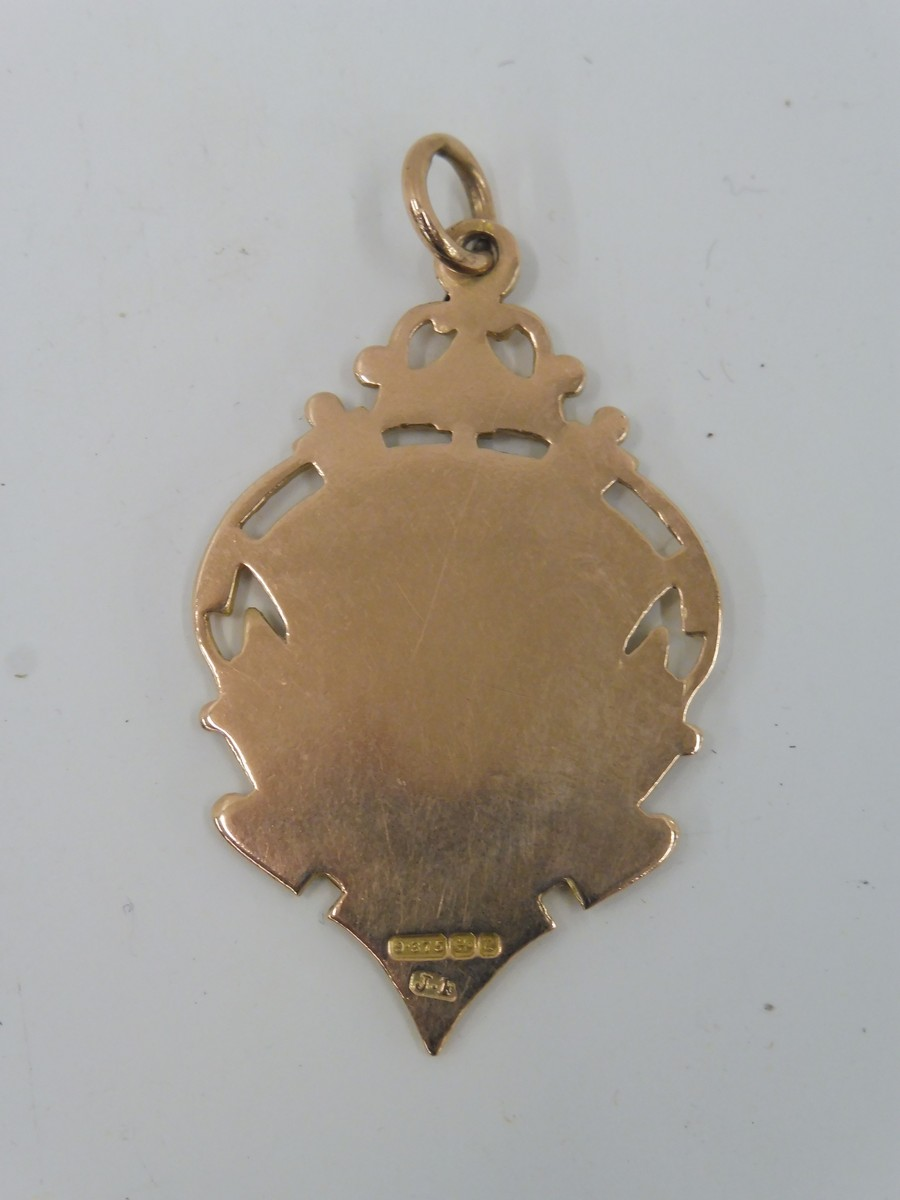 Lot 12 - A 9ct gold medal.