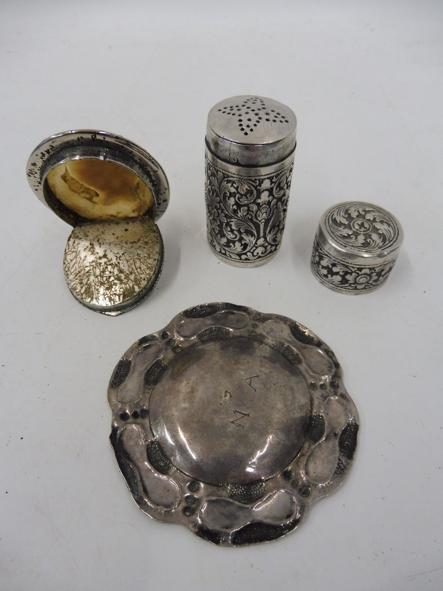 Lot 33 - An unusual naturalistic white metal dish, engraved with the letters N.A. to the reverse, a white