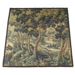 Lot 113 - A late 17th century Flemish verdure tapestry fragment, with a manor house in a woodland setting,
