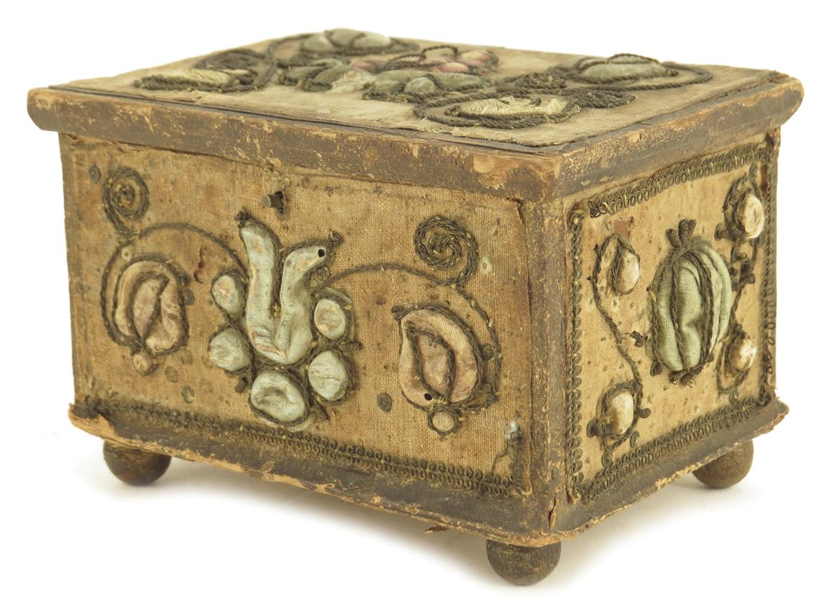 Lot 112 - A stumpwork casket, decorated with satin flowers with metal thread scrolls, with a paper lined