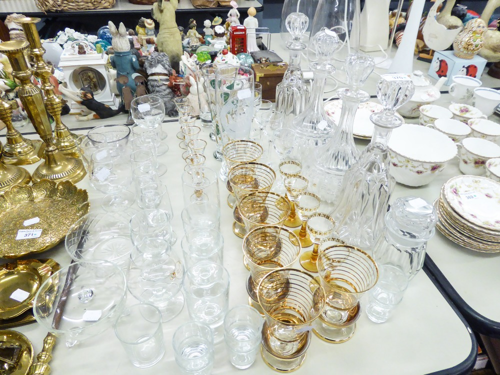 Lot 370 - QUANTITY OF GLASSWARES TO INCLUDE; FOUR GLASS DECANTERS, VARIOUS DRINKING GLASSES ETC....