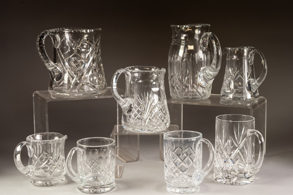 """Lot 250 - FIVE CUT GLASS JUGS, 7 ¼"""" (18.4cm) high and smaller, together with THREE CUT GLASS MUGS, 5 ½"""" (14cm)"""