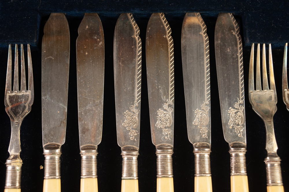Lot 427 - CASED SET OF SIX PAIRS OF FISH EATERS AND SERVERS, with bone handles and engraved blades, in a