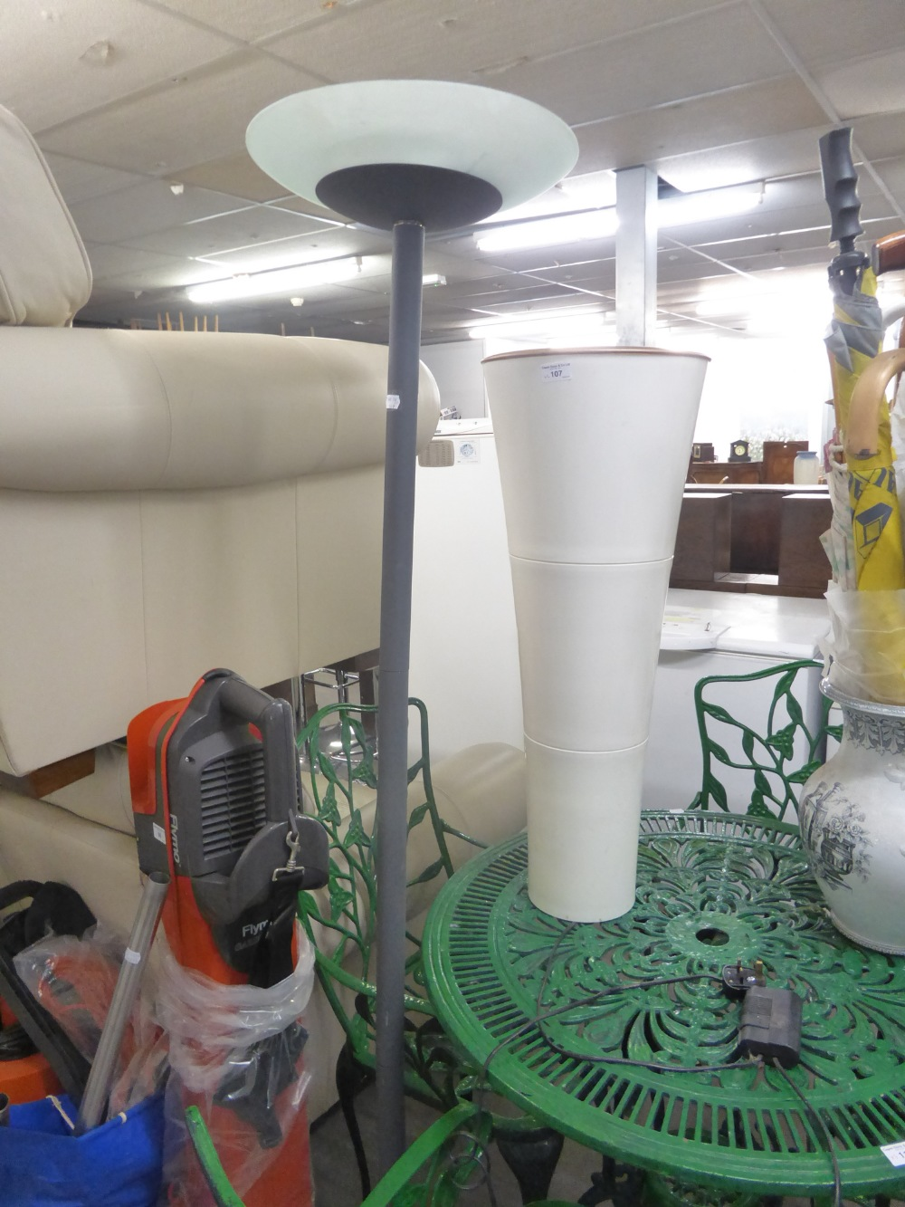 Lot 107 - A GREY METAL UP-LIGHTER STANDARD LAMP AND A MODERN WHITE PLASTIC LAMP (2)