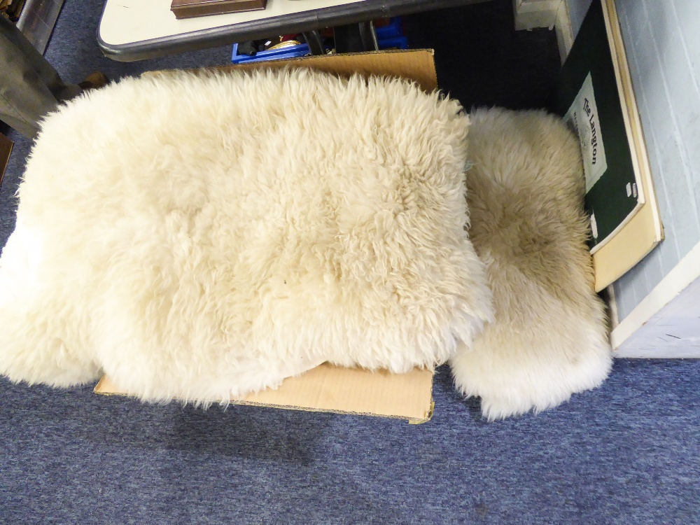Lot 422 - A PAIR OF NATURAL SHEEPSKIN RUGS AND FOUR LARGE CUSHIONS
