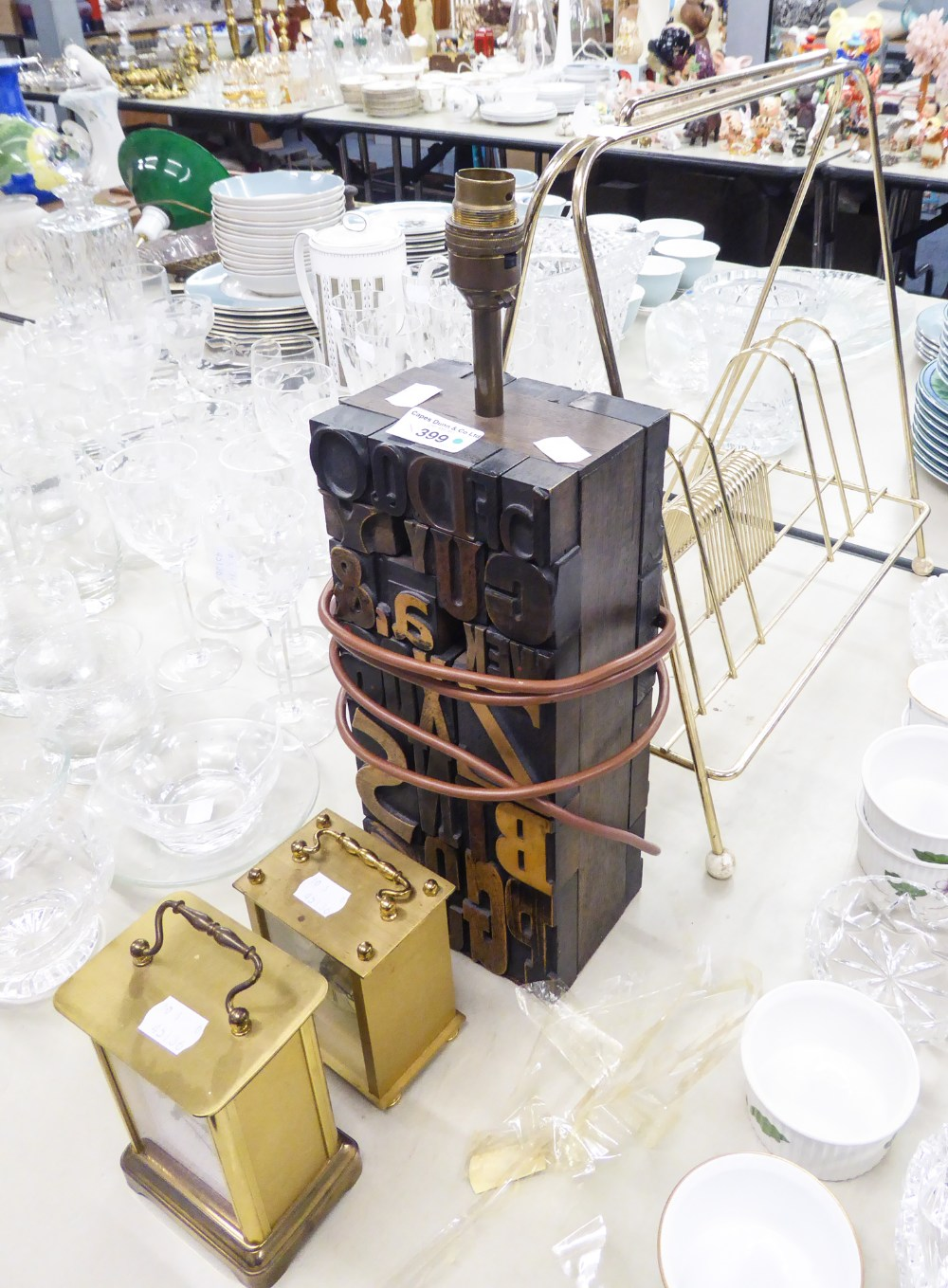 Lot 399 - TWO MODERN BRASS CARRIAGE CLOCKS, A BRASS MAGAZINE STAND AND A LETTER BLOCK TABLE LAMP (4)