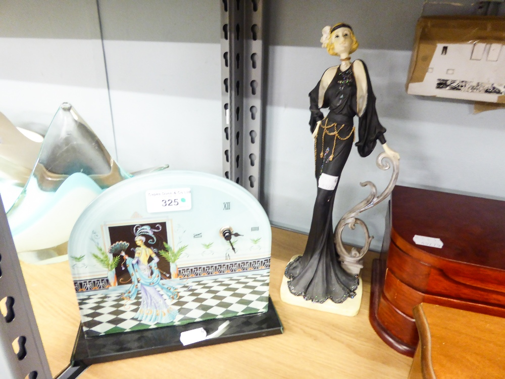 Lot 325 - A DECORATED GLASS AND SHAPED MANTEL CLOCK, BATTERY OPERATED AND A 1930's STYLE FIGURAL ORNAMENT