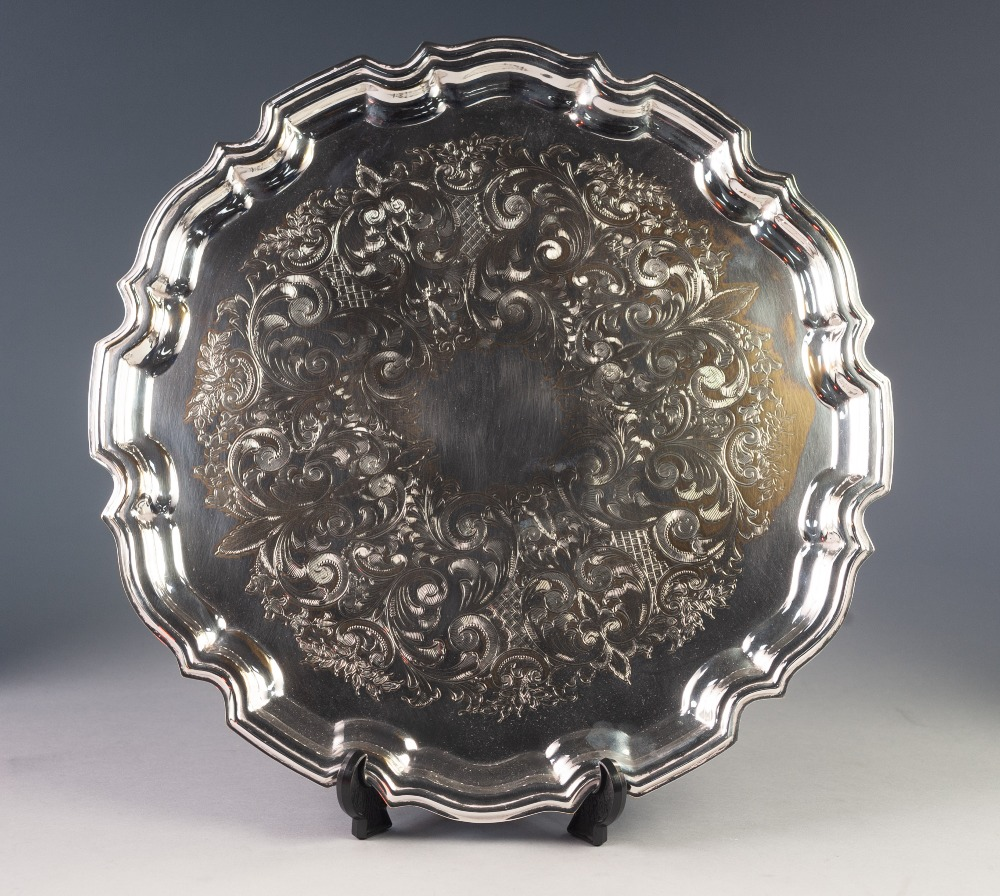 Lot 444 - MODERN CHIPPENDALE STYLE ELECTROPLATED TRAY, of circular form with wavy outline and foliate scroll