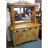 An oak Arts and Crafts mirrored back sideboard with carved panel doors Condition Report: