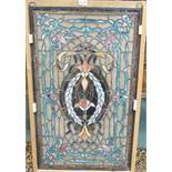 A leaded and stained glass panel, 86cm high x 52cm wide Condition Report:
