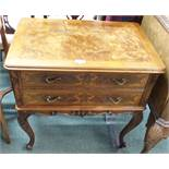 A reproduction walnut two drawer chest on legs Condition Report: Available upon request