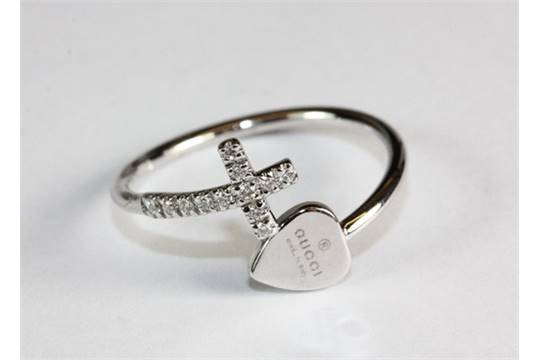 An 18ct white gold and diamond set Gucci cross and heart ring N