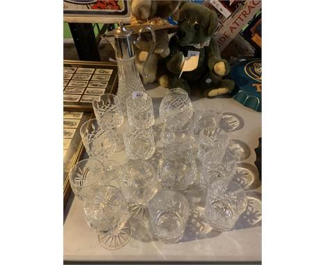 A COLLECTION OF CUT GLASS GLASSES AND A WINE CARAFE